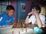 Victor playing chess with boy at orphanage